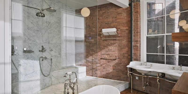 beautifully designed Dalton Georgia bathroom with frameless shower enclosure and stand alone tub.